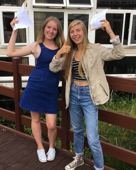 Emma Meredith and Charlotte Hadfield celebrate their results.