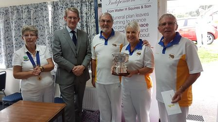 Ottery St Mary bowlers Terry House, Terri and John Ward with the Uffculme Triples Trophy