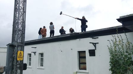 The Sky at Night crew filming on the roof. Picture: David Strange