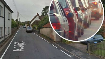 Traffic is queuing on Newton Poppleford's high street this morning. Photo: Google Earth