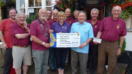 The Lions Club of Sidmouth presented a cheque of £550 to the East Devon group of the Riding for the