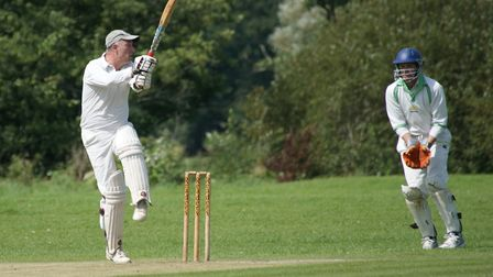 Tipton St John batsman Phil Tolley hits out on his way to a century (104) in the meeting with Met Of