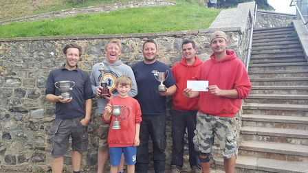 Barry Trevett, (centre in black), who was the overall winner of the Honiton Sea Angling Club Beer Re
