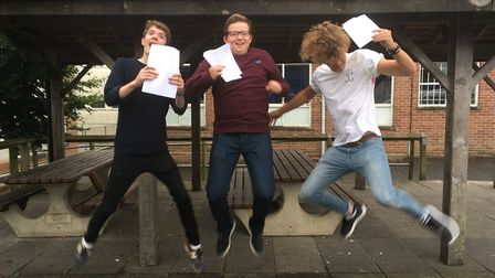 Adam Spicer, Matthew Shepherd and James Truscott jump for joy at their results.