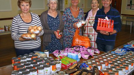 Sidmouth food bank volunteers, Penny Lamb, Renee Forth, Lois Swarbrick, Jean Wadsworth and Ian Lawes