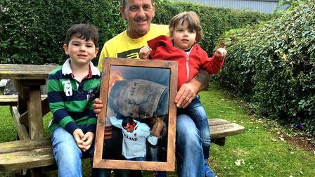 Kev Carter with his sons Archie, 4, and Zack 2, has dedicded to stop rolling tar barrels after 50 ye