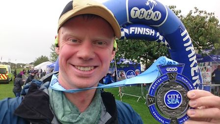 Sidmouth Running Clubs Jim Forrer with his City to Sea Marathon medal