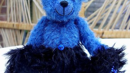 A Haven Bear named Deene made in the Prostate Cancer UK colours is being raffled off by Sidmouth Gif