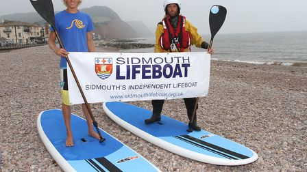 Guy Russell and Guy Bennett will be paddle boarding The Jurassic Coast. Ref shs 4920-36-14TI. Pictur