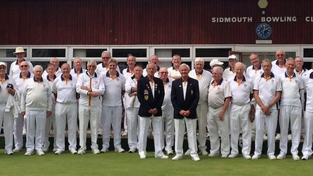 Sidmouth men line up before the start of play at the annual Captain's Day meeting at the club