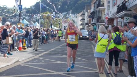 Bill Valentine, a second claim Sidmouth Running Club member, completes the 2017 Dartmouth Regatta ro