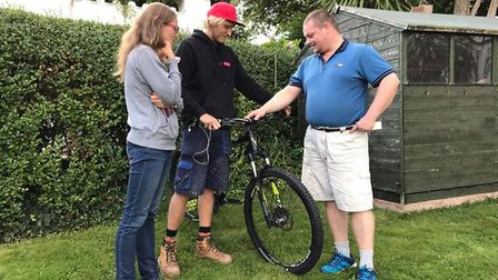 Guy Bennett (centre) was reunited with the bike he thought was stolen. Nicolae had been keeping it s