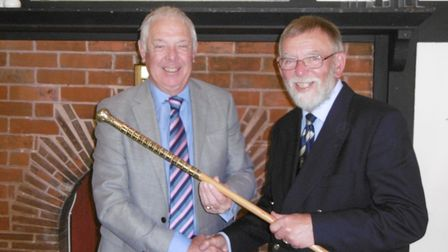 Ray Gunston receives the Walking Stick trophy from Sidmouth seniors captain Bruce Harcourt