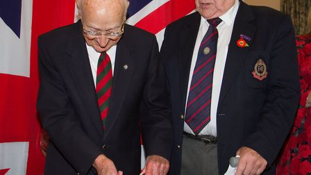 George Bastone cuts the cake with Les Andrews at the launch of Beer's Royal British Legion. Ref shb