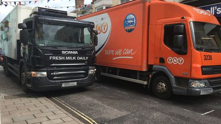 A solution has been called for in Fore Street as heavy vehicles are forced to drive on the pavement