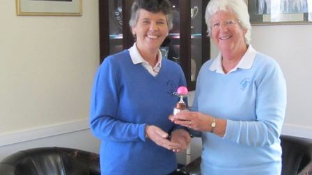 Sidmouth ladies captain Maria Clapp receiving the cup from ladies secretary Sue Langdon