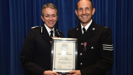 Sergeant Richard Holland receives his commendation from Chief Constable Olivia Pinkney.