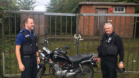 PCSO Jack Stannard and PC Steve Blanchford-Cox with Lawrence Matthews recovered motorbike that was s