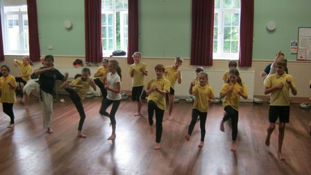 Students in key stage two learn taekwondo