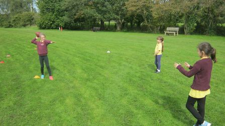 The youngsters try American football.