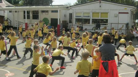 The whole school participates in a dance workshop during sports week.
