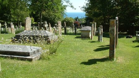 View across the churchyard in Salcombe Regis to the sea. Photo credit - John Rolfe.