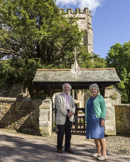 Sheelagh Michelmore MBE and Dr Philip Atkinson beside the lych gate of St Mary and St Peter's churc