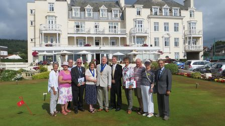 Sidmouth in Bloom proudly show off the town to judges.