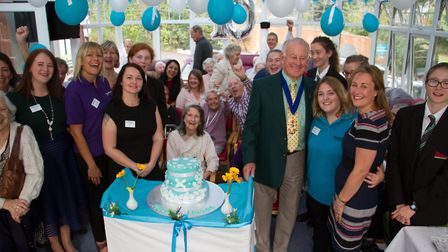 Staff and residents with Cllr Ian McKenzie celebrateing ten years of Malden House. Ref shs 39 17TI 1