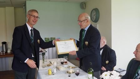 Clive Dwerryhouse receives a certificate from Terry O'Brien after he was confirmed as one of the fou