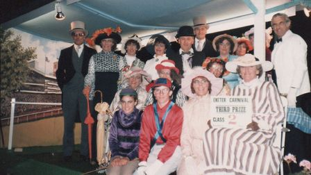 Members of the Primley Wives Club participating in Sidmouth Carnival in 1985, the theme was ladies d