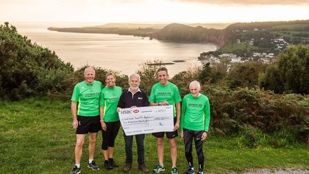 The presentation of a cheque tro the SW Coast path group (left to right) Sidmouth Running Club chair