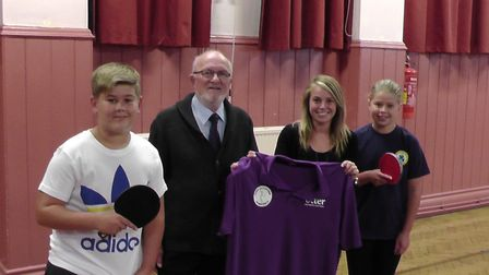 Sabine Taylor, the marketing and visual manager at Otter Nurseries, hands over the new league shirt