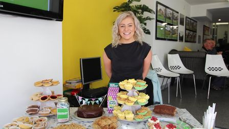 Staff member Charlie Gwillim with the delicious range of homemade cakes.