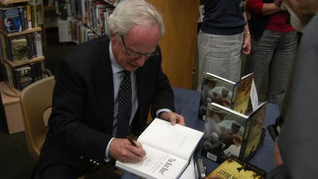 Author Jonathan Walker signing books at Sidmouth Library
