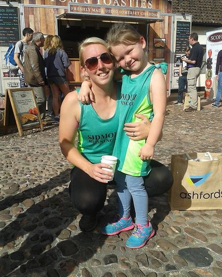 Sidmouth Running Club member Laura Phillips and her daughter Mollie at the end of the Muddiford Chee