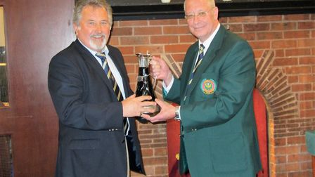 Mike Dommett, the Sidmouth B team captain being presented with the Claret Jug by club captain Richar
