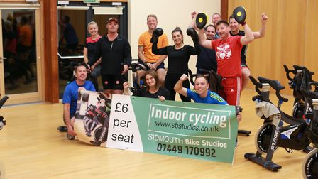 Matt Meek (middle in black) is gearing up to open Sidmouth's first indoor cycling centre. He will be