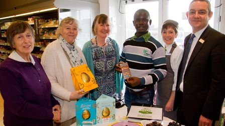 Fairtrade farmer Isaac Biadoo with Wendy Spratling,Jan Wheeler and Julie Ridings of Sidmouth Fairtra
