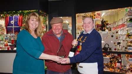 President of Sidmouth chamber of commerce Derek Parry with Colin and Kylie Cramb of Coles, the winne