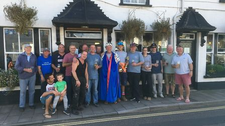 The anglers who took part in the annual Black Rod fishing competition outside the Swan Inn.