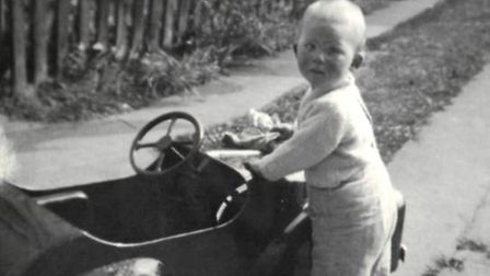 Ian Gregory as a toddler with his Triang pedal car