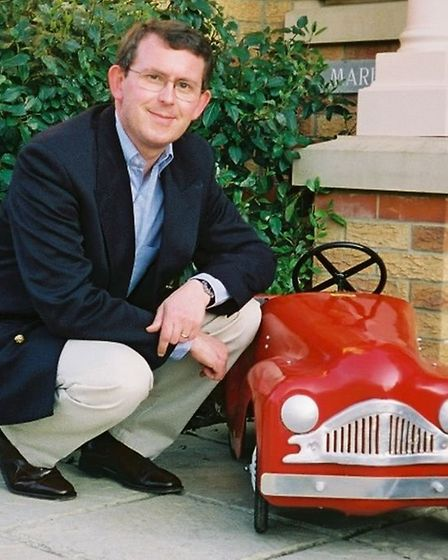 Ian Gregory with his Triang pedal car, which he had restored to its original colour