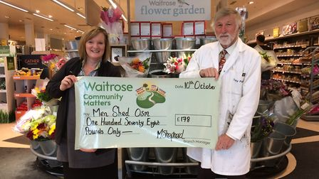 Tony Pugh collects a cheque from Waitrose's Community Matters scheme.