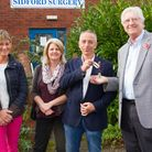 Ian Barlow handing over the keys of the old Sidford surgery to Barry Lowden, the chairman of Sidmout