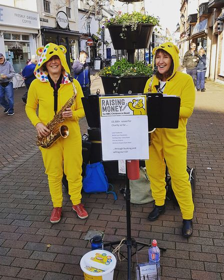 Saxophone duo Small Change donned Pudsey onesies and played in Sidmouth's Market Place to net more t