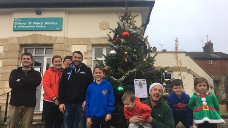 Helpers arrived at 8am to help James Trevett (middle sitting) replace the tree outside Ottery Librar