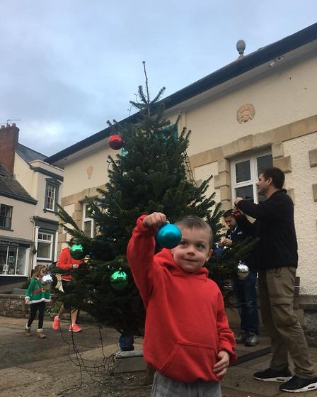 Helpers arrived at 8am to help James Trevett replace the tree outside Ottery Library after it was br