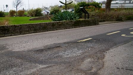 Pothole at Three Corner Plot in Sidmouth. Ref shs 47 17TI 3605. Picture: Terry Ife