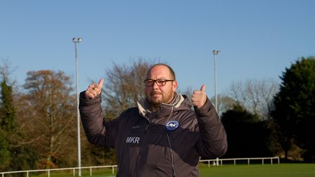 Ottery St Mary AFC chairman Mike Ringer points to the floodlights that will soon be replaced. Ref sh